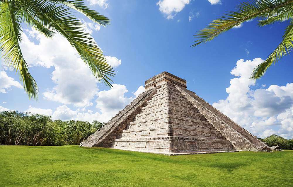Chichen Itza monument on the green grass during summer in summer, Mexico
